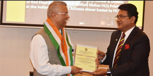 Felicitating Indian High Commissioner HE Dr A M Gondane at his farewell with a Certificate of Commendation